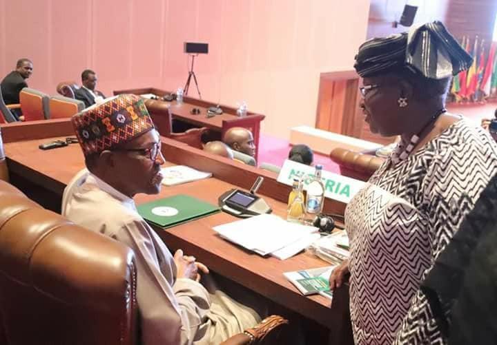 Photos: President Buhari and ex-Finance Minister, Ngozi Okonjo-Iweala, meet at AU summit