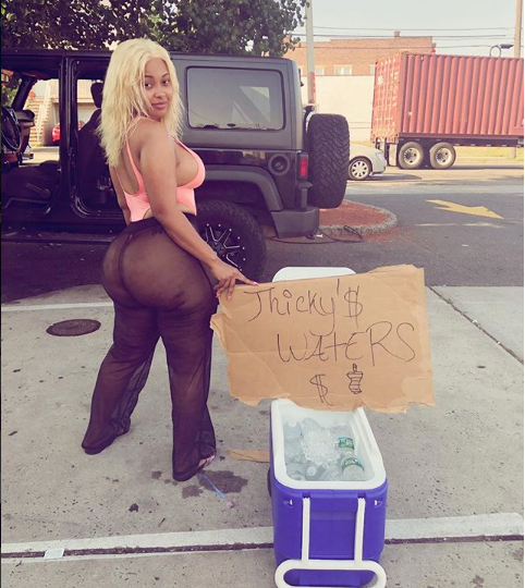 Curvy Instagram model causes traffic in New Jersey as she goes nearly naked to hawk water ?(Photos/Video)