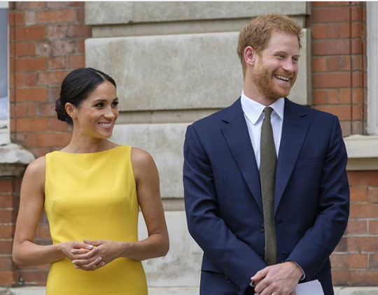 Meghan Markle dazzles in bright yellow dress as she joins Prince Harry at a Commonwealth youth reception in London (photos)