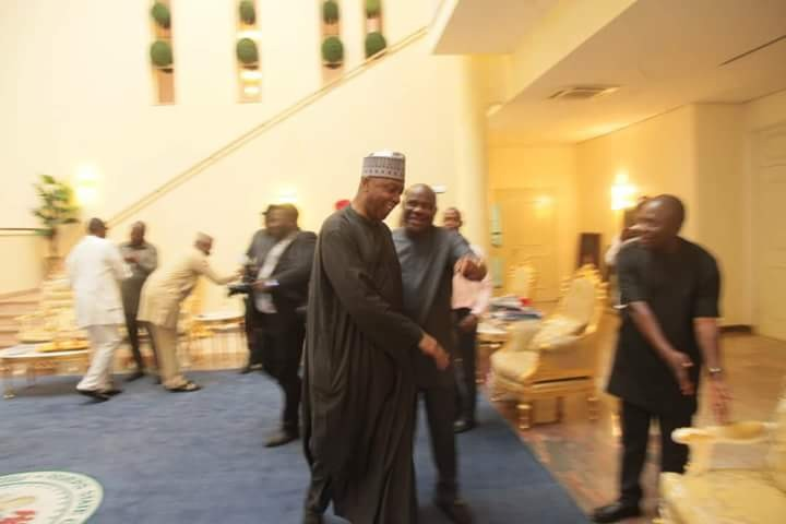 Photos: Senate President Bukola Saraki visits Nyesom Wike with PDP displayed  in the background