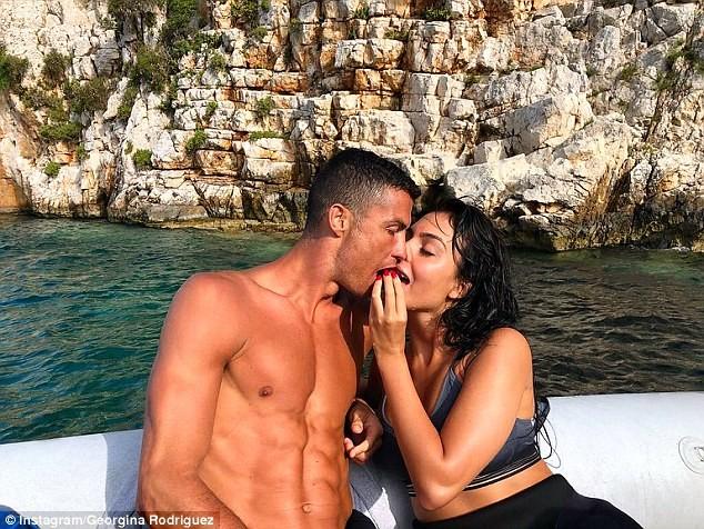 Cristiano Ronaldo lock lips with his girlfriend Georgina as they enjoy family holiday ahead of his