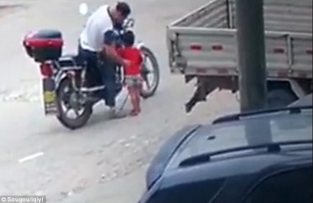 Chilling moment human trafficker abducts a little girl by luring her with snacks before dragging her onto his motorbike (video)