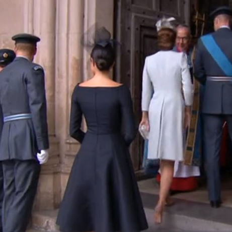 Duchess of Sussex stands out as the Royals join the Queen for a service at Westminster Abbey to mark the centenary of the Royal Air Force