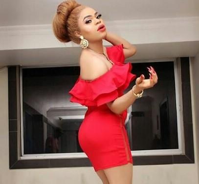 Bobrisky looks red hot in curve-hugging dress