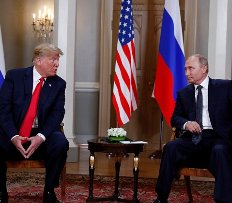 Donald Trump and Vladimir Putin meet face to face ahead of 90-minute private talks aimed at rebuilding ties between US and Russia