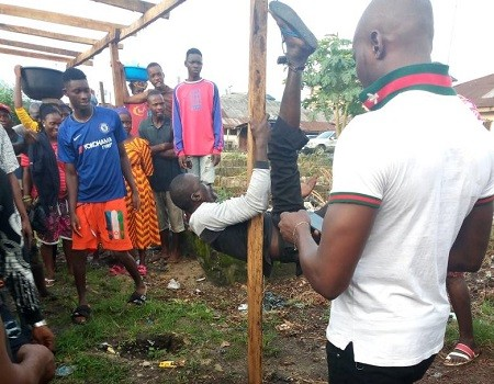 Middle-aged man tied to a stake, given the beating of his life by angry youths for raping 7-year-old girl in Warri
