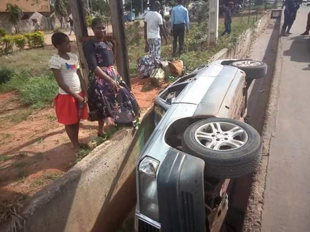 Mother and daughter miraculously survive crash as car somersaults, plunges into drainage in Anambra