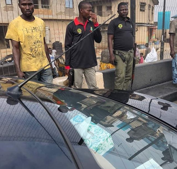 Woman cries out after being harassed by drunk Nigerian police officers who bashed her car