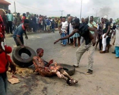 Graphic photos: Man set ablaze for stealing motorcycle in Akwa Ibom