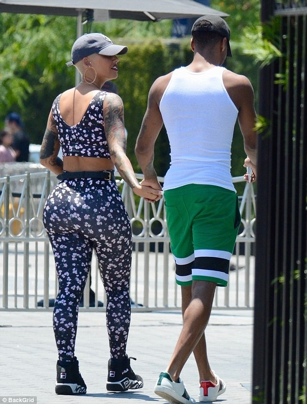 Amber Rose, 34, holds hands with her new NBA