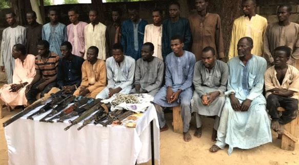 Photos: Eight suspected kidnappers of Chibok schoolgirls paraded by Nigerian Police in Maiduguri