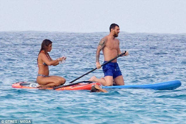 Lionel Messi goes paddle-boarding in Ibiza with wife Antonella Roccuzzo and Cesc Fabregas