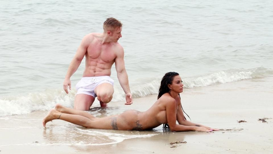 Photos: Katie Price strips completely naked for a skinny-dipping session on a beach with toyboy beau Kris Boyson 18+