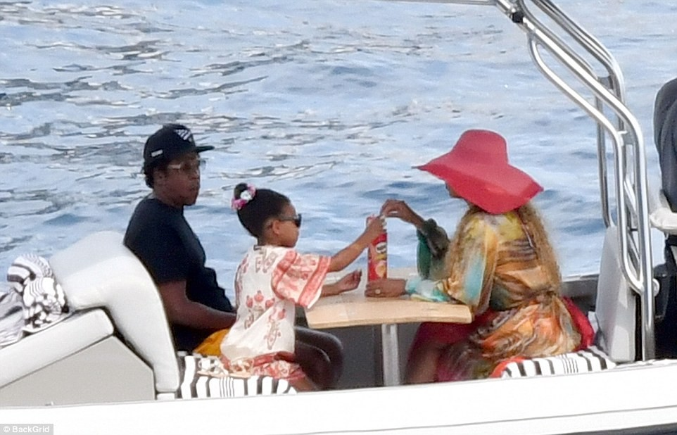 Beyonc? and Jay-Z enjoy a relaxing afternoon on $180million luxury yacht with their three children in Capri (Photos)