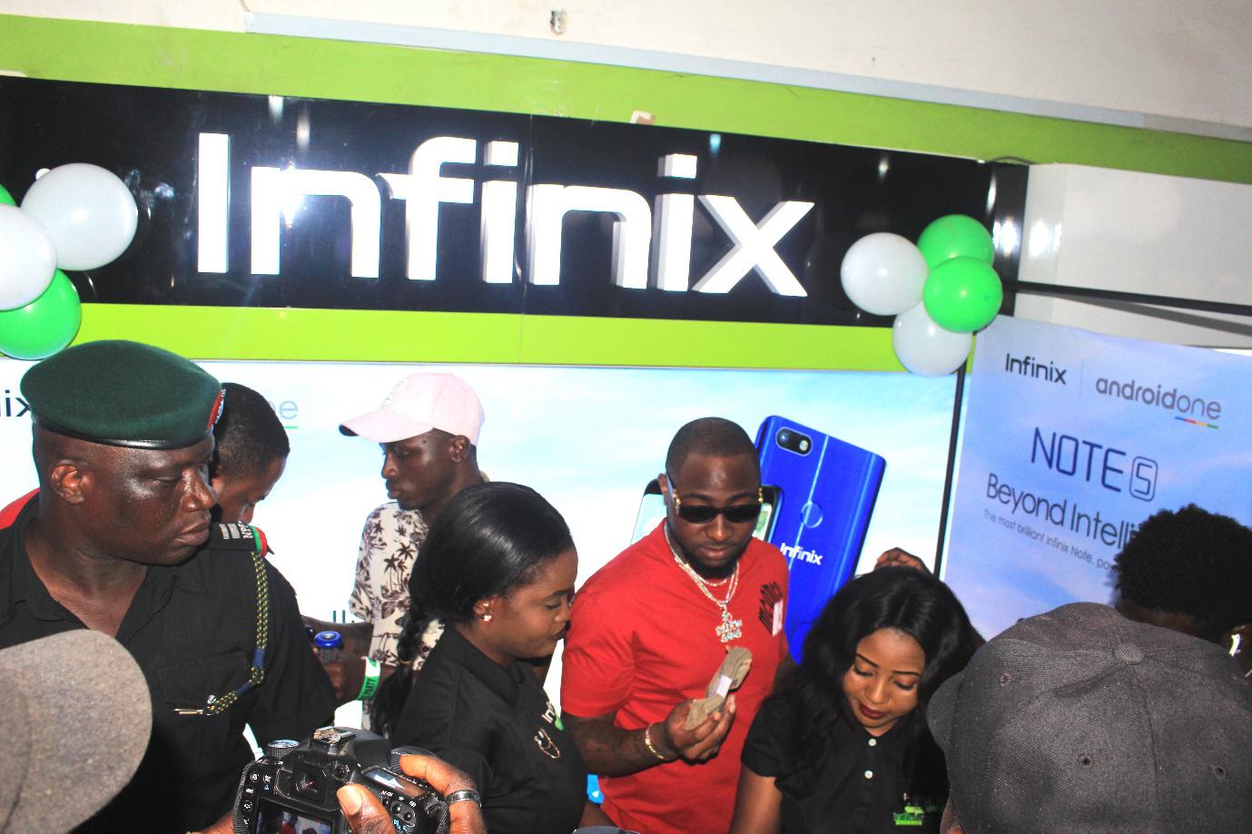 Davido visits Infinix authorised retail store and buys new Infinix Note 5
