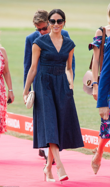 Proud wife Meghan Markle looks elegant as she arrives to cheer on Prince Harry as he takes part in the Sentebale Polo Cup