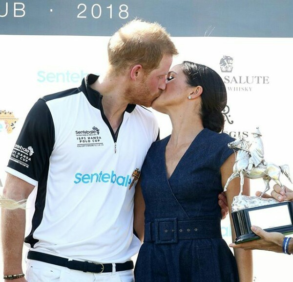 Duke and Duchess of Sussex, Meghan Markle and Prince Harry share a kiss