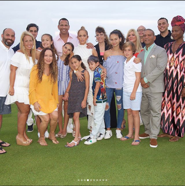 Jennifer Lopez shares a kiss with her beau Alex Rodriguez as they celebrate his 43rd birthday with family & friends (Photos)
