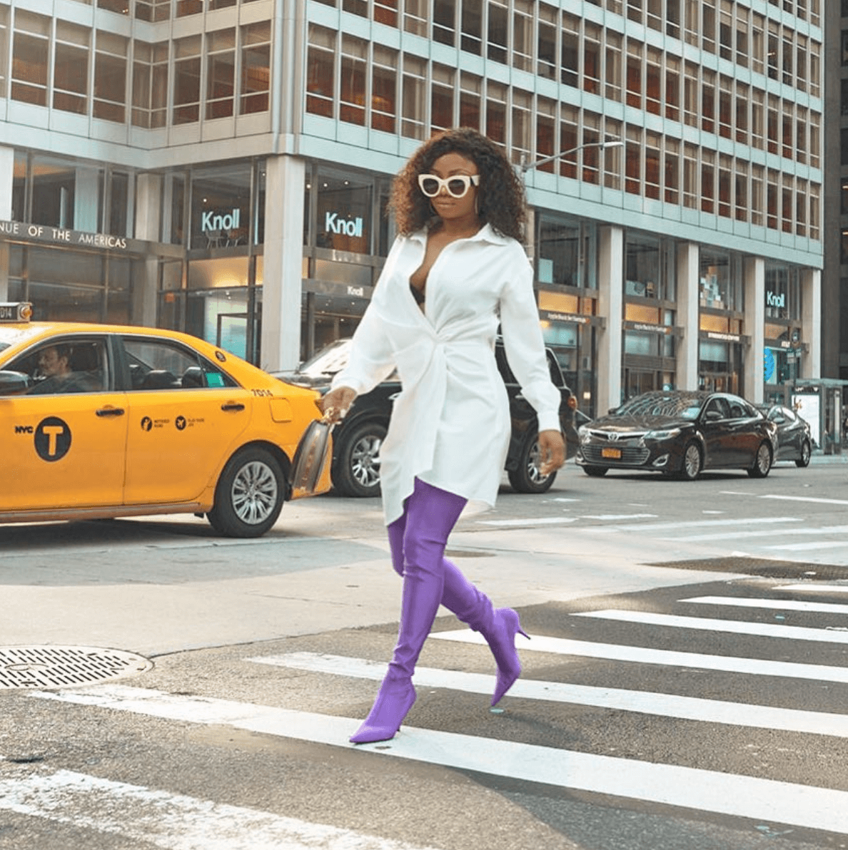 Toke Makinwa rocks N500k purple spandex Balenciaga boots on the streets of New York(photos)