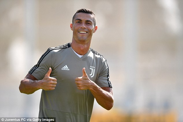 Cristiano Ronaldo meets his new team-mates as he trains for the first time since joining Juventus in a ?100million move (Photos)
