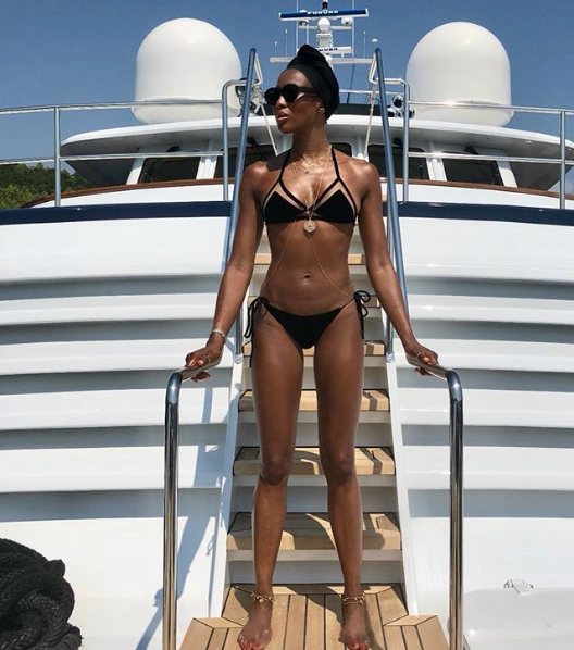 Naomi Campbell shares bikini photo exposing her bare stomach amid speculations she might be the one carrying Skepta