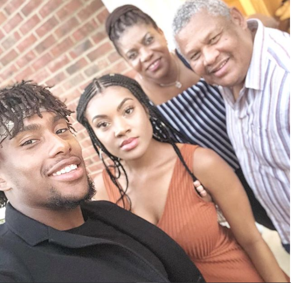 Super Eagles star Alex Iwobi shares beautiful family photo with his parents and sister