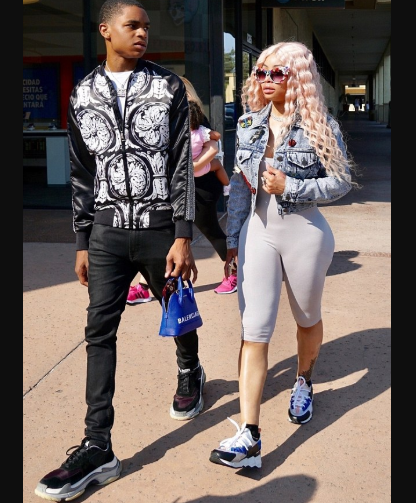 Blac Chyna's 18-year-old boyfriend carries her handbag as they step out for lunch in LA (Photos)