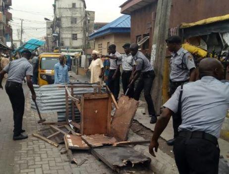 Lagos CBD demolishes criminal hideout in Marina, arrest 10 area boys