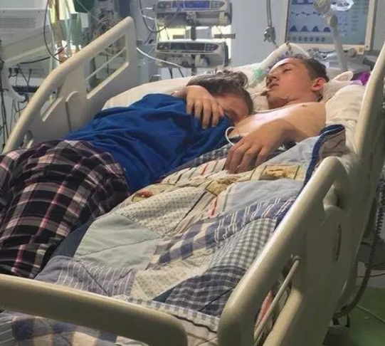 Heartbreaking moment teenager cuddles her boyfriend on his deathbed before life support is switched off