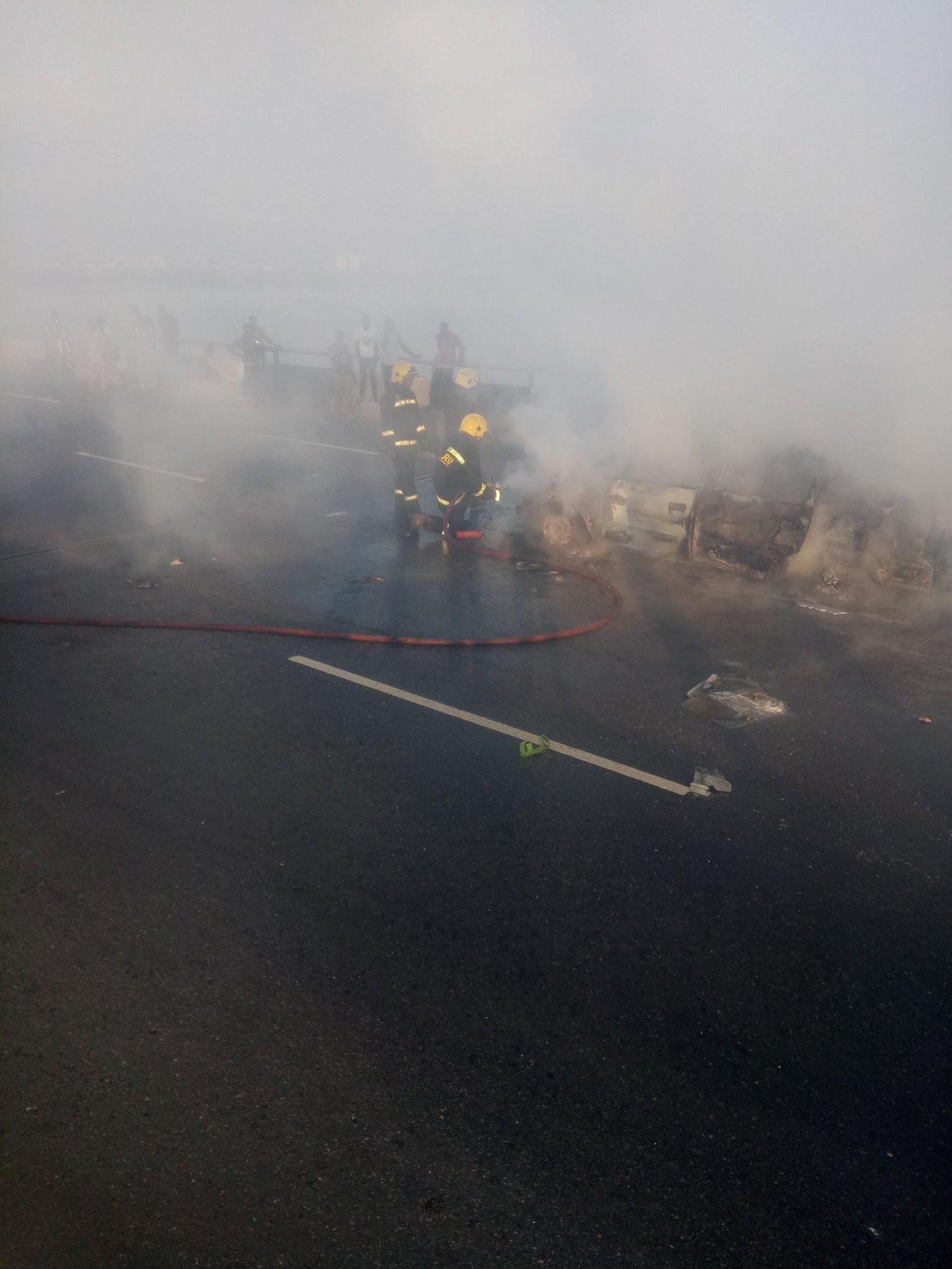 Photos: LASEMA puts out the burning mini van on Third Mainland Bridge