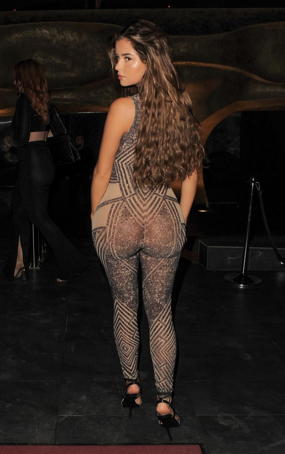 Demi Rose goes braless in see-through skintight catsuit (photos)