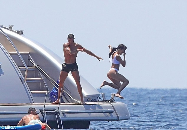 Cristiano Ronaldo throws bikini-clad girlfriend Georgina Rodriguez into the sea as they enjoy yacht trip in Ibiza (Photos)