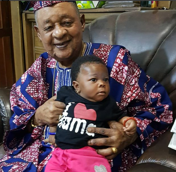 Lovely photos of Alaafin of Oyo and his twin baby girls
