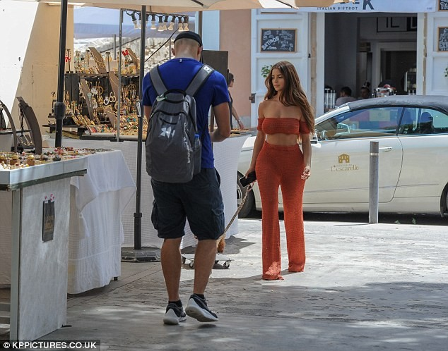 Demi Rose goes underwear-free in racy sheer crochet co-ords in Ibiza....but fans notice a little more (Photos)