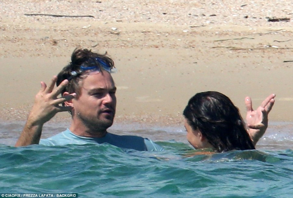 Actor Leonardo DiCaprio, 43 and his 21-year-old girlfriend Camila Morrone lock lips in deep passionate kiss during sun-drenched French getaway (Photos)
