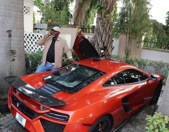 Dino Melaye shares photos of himself posing beside his Ferrari