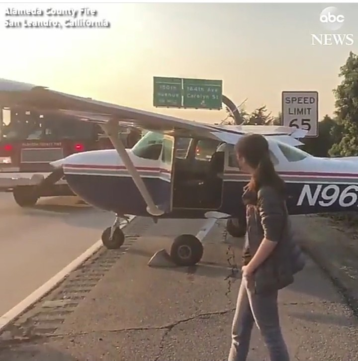 Shocking moment a small plane made an emergency landing on a highway caught on dashcam