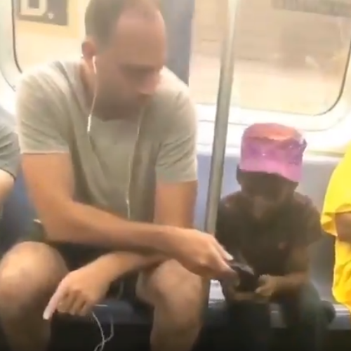 White man goes viral for what he did when he noticed a black kid peering into his phone in a bus (video)