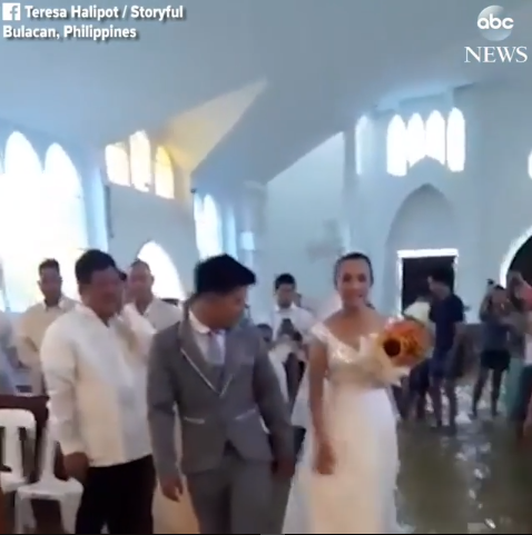 Couple tread water to get married in a flooded Philippines church (video)