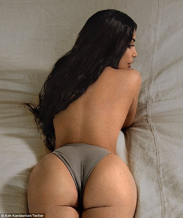Topless Kim Kardashian flaunts her perky derriere in tiny underwear as she lounges in bed? (Photos)