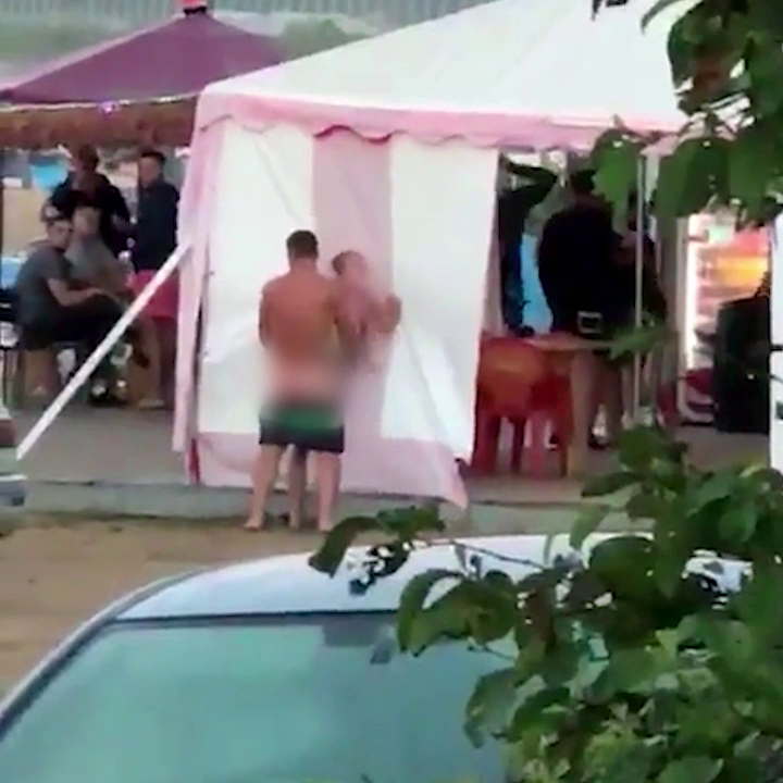 Shocking moment randy couple are caught repeatedly having sex at a beach resort in front of shocked onlookers (Photos)
