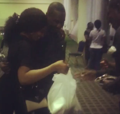 Ibidun Ighodalo gets surprise visit from her hubby at work...and he brought her food! Awww...