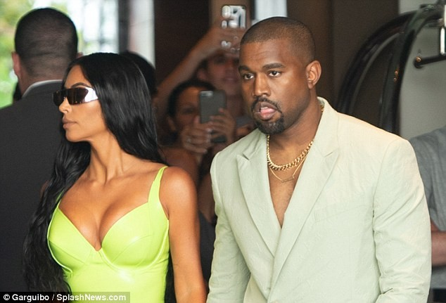 Kanye West carries Kim Kardashian out of their G Wagon and grabs her butts as they arrive at 2 Chainz
