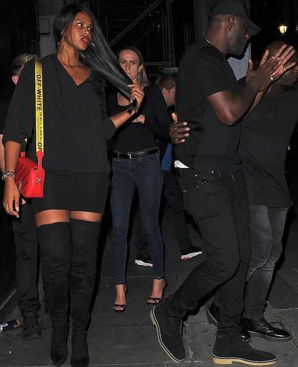 Idris Elba and his fianc?e Sabrina Dhowre step out in matching black ensembles as they enjoy night out in London (Photos)