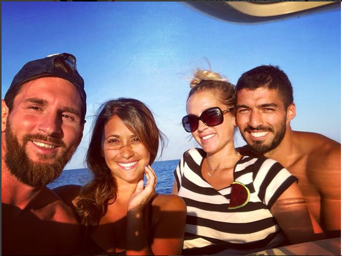 Football stars, Lionel Messi and Luis Suarez enjoy time off at the sea with?their pretty wives (Photos)