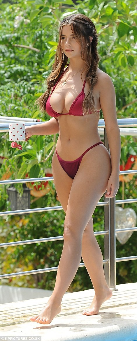 Demi Rose flaunts her eye-popping curves and pert derriere in skimpy bikini (Photos)