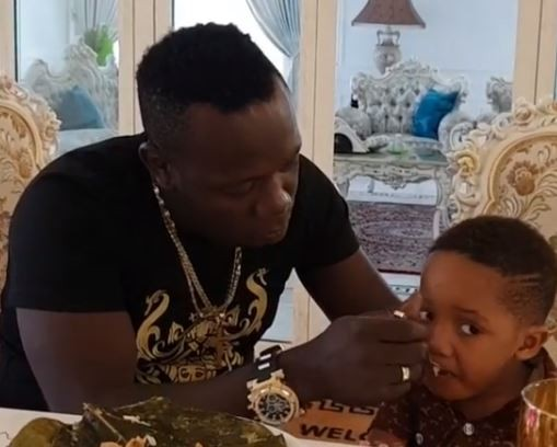 Duncan Mighty shares video of himself feeding his son amidst