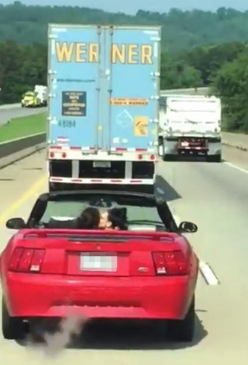 Women driving on highway go naked and perform sexual acts on each other to entertain horrified truck driver behind them (video)