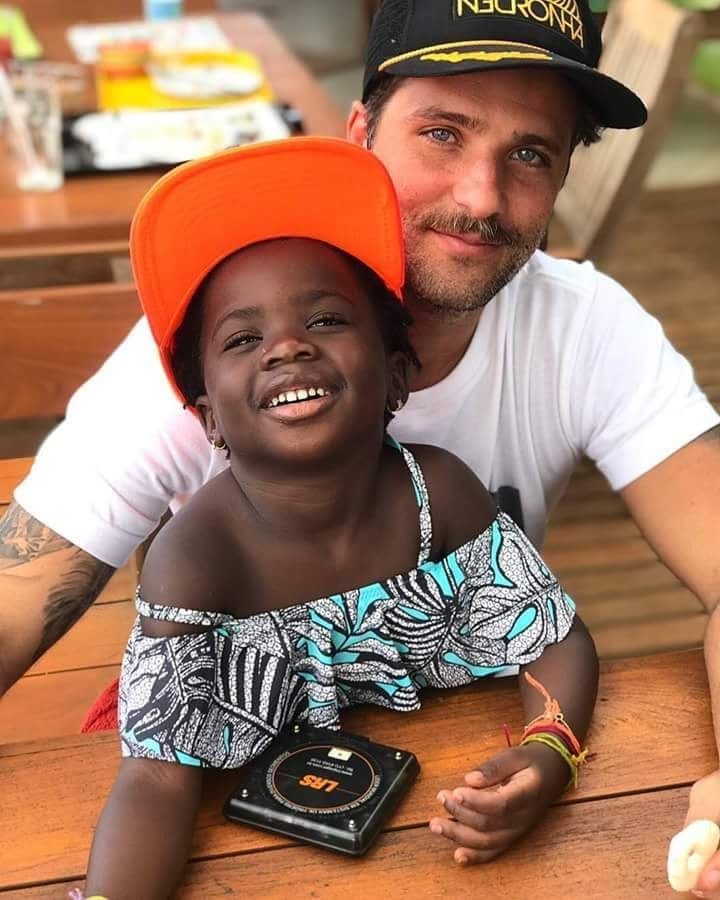These pics reportedly show a white man and his adopted black daughter