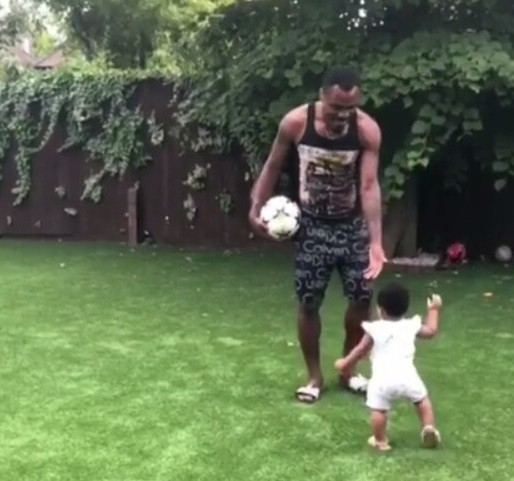 Adorable photos of Super Eagles player, Emmanuel Emenike playing with his daughter